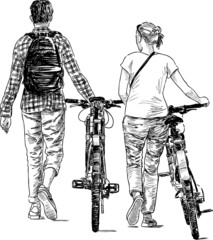walking young people with bicycles
