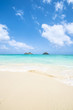 tropical Lanikai beach in Oahu Hawaii with two islands