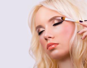 Beautiful blonde girl with perfect makeup