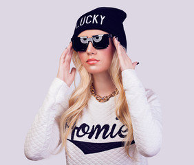 Portrait of beautiful blonde girl with sunglasses