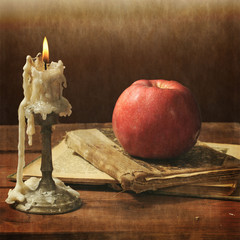 Still life, apple and candle, Vintage.