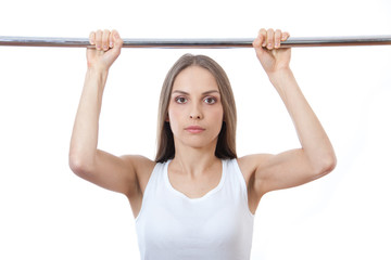 woman exercising on pull-up bar