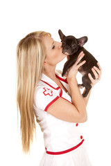 nurse with small dog hold kiss