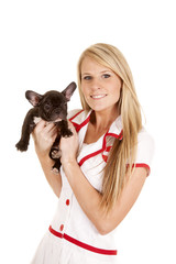 nurse with small dog hold look