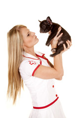 nurse with small dog hold side
