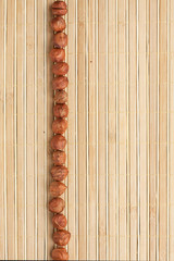 Cases a band of  hazelnut   lying on bamboo mat