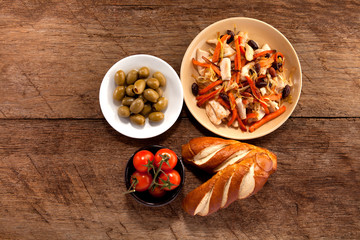 Dish with meat, tomato, bread and olives