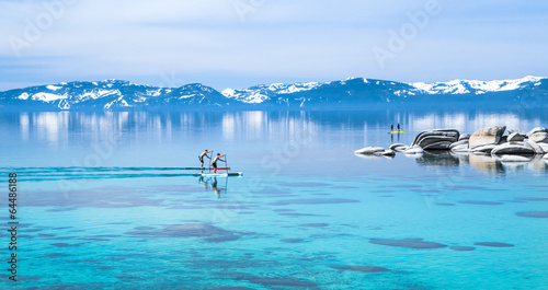 Foto op Canvas Grote meren Paddle boarding