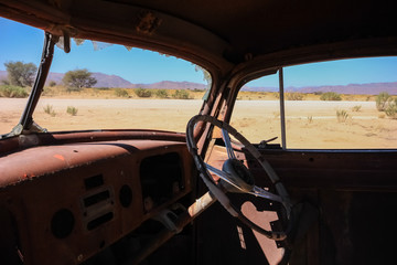 Inside of a rotten Oldtimer at Solitaire, Namibia