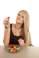 woman eating jelly beans hold black one
