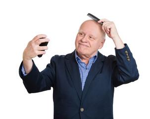 Narcissism. Proud of himself senior man looking in mirror