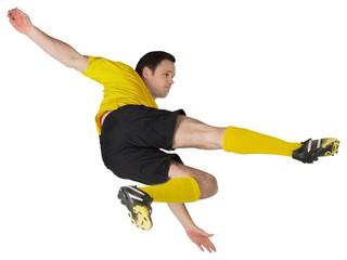 Football player in yellow kicking