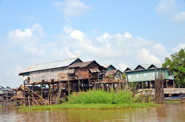 Houses on stilts in which people live in the village