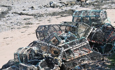 Pile of lobster of creel pots on beach