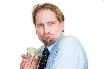 Greedy man possessive of his money, obsessed with cash