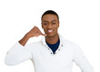 Young handsome man giving call me sign, on white background
