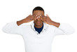 See, hear, speak no evil concept. Young man on white background