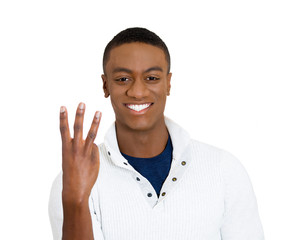 Portrait handsome young man giving three gesture sign