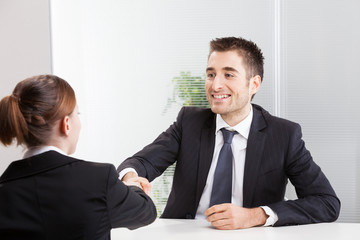 Business people having job interview with young woman.