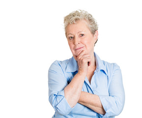 Wise old woman looking at you deciding isolated white background