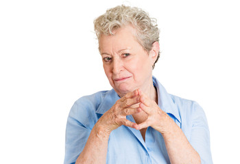 wicked old woman planning revenge isolated on white background