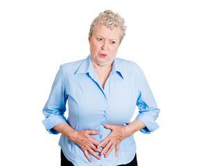 Abdomen pain. Senior woman has stomach pain, on white
