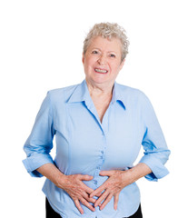 Senior female  has abdomen pain holding belly with hands