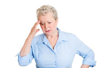 Confused sad senior woman, thinking, daydreaming