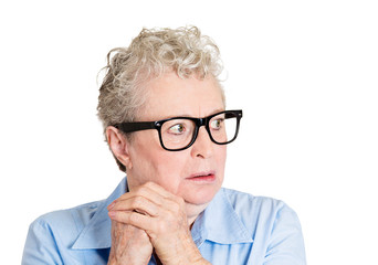 Paranoia. Deranged, anxious, senior elderly woman with glasses