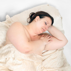 Overweight woman sleeping.