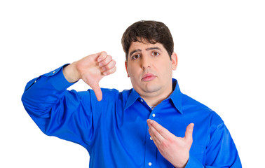 Upset sad man giving thumbs down gesture