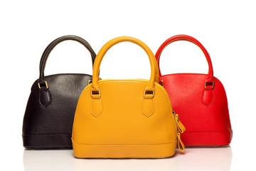 three purses on white background
