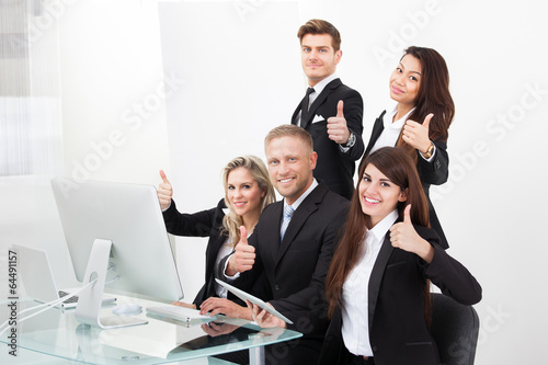 Confident Business Team Showing Thumbs Up