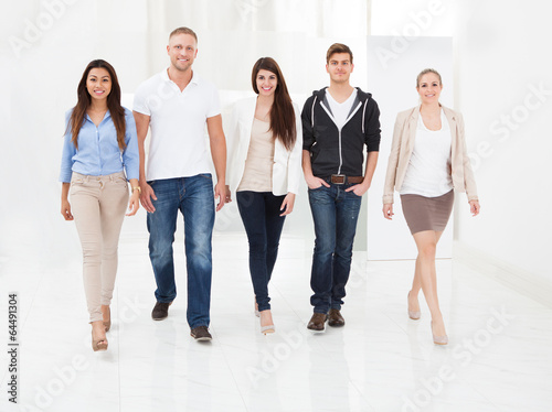 Confident Businesspeople Walking Together