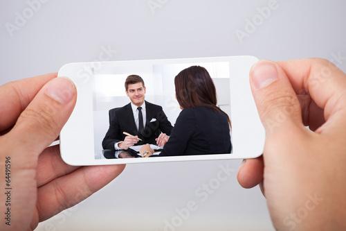 Man Watching Movie On Smart Phone