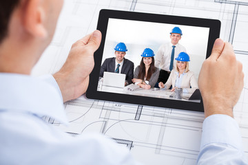 Architect Video Conferencing With Team Through Digital Tablet