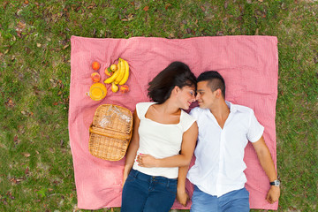 Young couple lying on the ground in the park