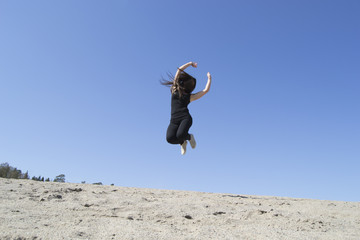 Woman jumping high (sand, beach, top, happiness, energy)