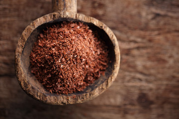 fine grated chocolate in old wooden spoon