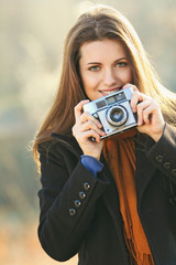 Portrait of a smiling beautiful woman with camera