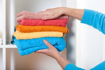 Putting towels on shelf