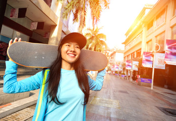 skateboarding woman take a skateboard at city street
