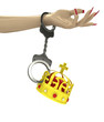 royal crown attached with chain to human hand