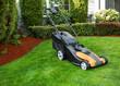 Leinwanddruck Bild - Electric Battery Lawn Mower on Front Yard