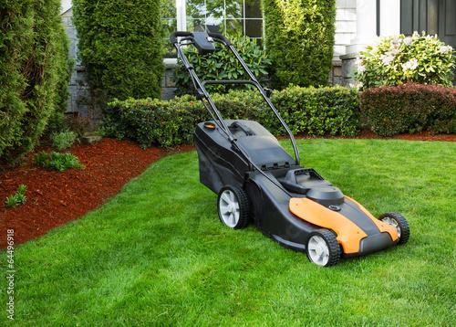 Leinwanddruck Bild Electric Battery Lawn Mower on Front Yard