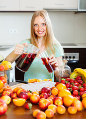 cheerful woman pouring beverages   to glass