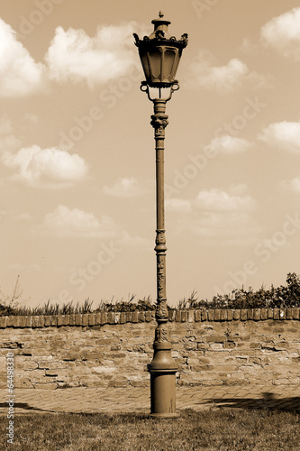 Old street lamp in sepia color. - 64498330