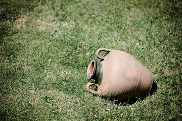 ancient jug are on grass-plot