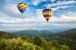 Leinwandbild Motiv Hot air balloon over the mountain