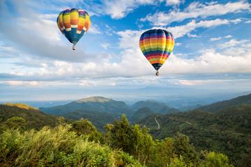 Hot air balloon over the mountain